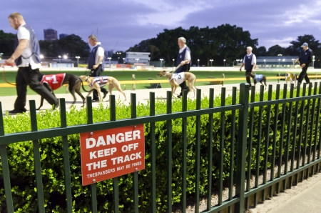 trespasser: Keep off sign at the greyhound racing track