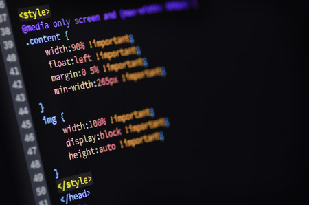 orthographic symbol: Closeup of media querry html and css code of web page displayed on a computer monitor Stock Photo