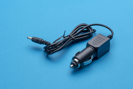 Car Charger Car Adapter for Cigarette Lighter isolated on blue background