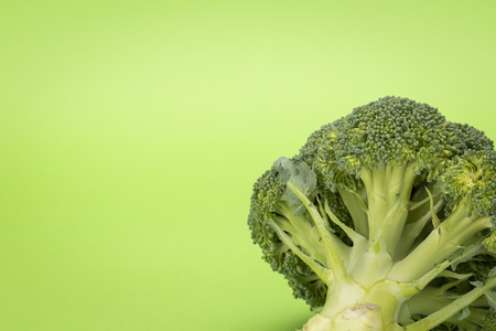 Broccoli isolated on green background, fresh, healthy food