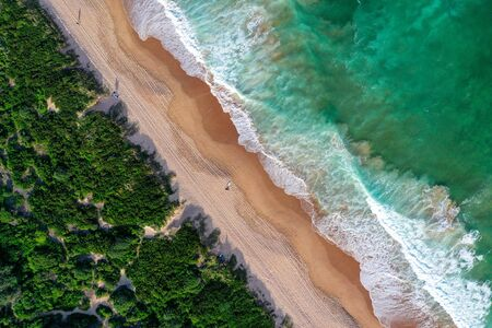 Beach aerial view from drone beach shadow people sunrise