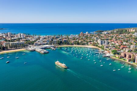 Aerial view on famous Manly Wharf and Manly, Sydney, Australia. View on Sydney harbourside suburb from above. Aerial view on Sydney North Harbour, Manly and Manly Wharf.
