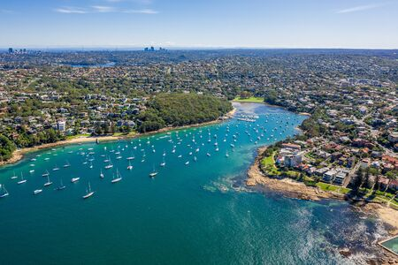Aerial view on Reef Bay, Sydney, Australia. View on Sydney harbourside suburb from above. Aerial view on Forty Baskets Beach, Reef Bay and Sydney in the background.
