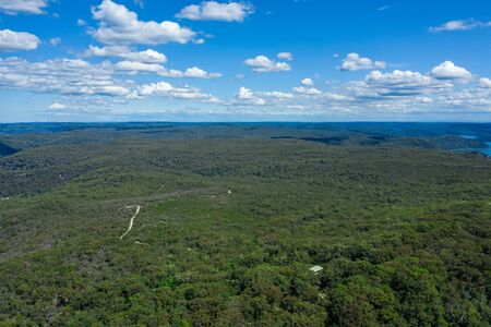 Aerial view of hills and forest at Ku-ring-gai Chase National Park, New South Wales, Australia