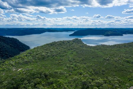 Aerial view of hills, forest and Hawkesbury River at Ku-ring-gai Chase National Park, New South Wales, Australia