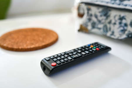 Close up of a TV remote on white background, shallow depth of the field.
