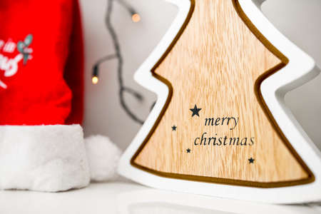 Close up image of christmas tree, christmas lights and Santa Clause hat on white background 스톡 콘텐츠