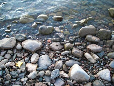 Rocks in the lake Stock fotó