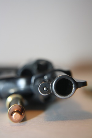 revolver: .38 special gun lying on table with bullet