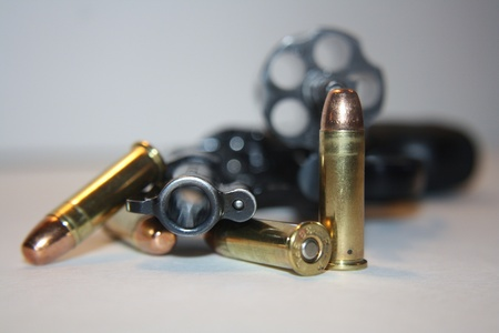 concealed: .38 special gun with bullets and opened barrel ready to reload Stock Photo