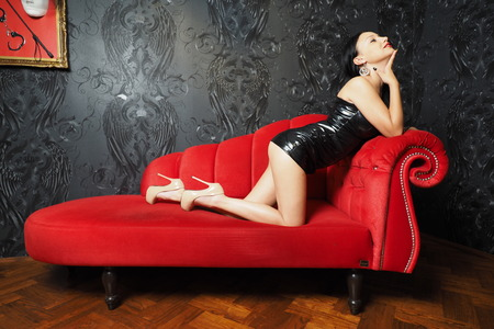 domina: Mistress on red couch