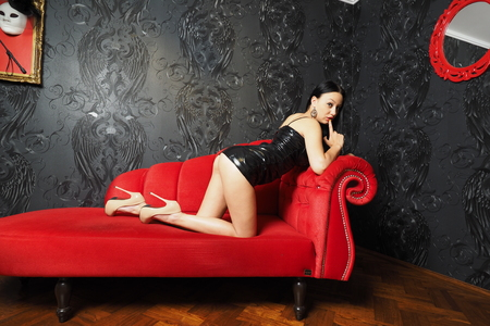 Mistress on Red Sofa