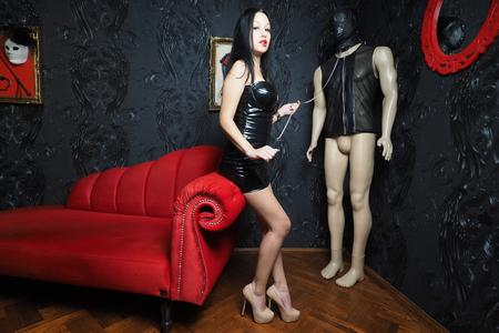 domination: Mistress Whip Domination Stock Photo