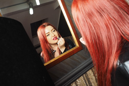 herrin: Glamour Mistress with red lips