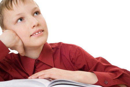 beautiful boy with a book and dreams photo