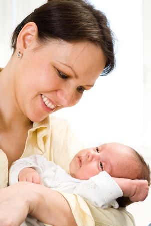 young mother stands and holds the baby Stock Photo - 9226499