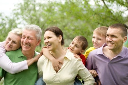 large family plays in the summer park Stock Photo - 9226609