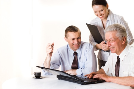 Three businessmen working together on a white Standard-Bild