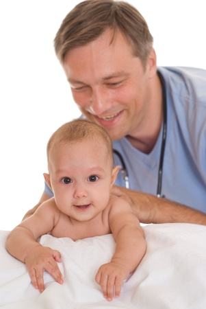 doctor examining newborn on a white photo