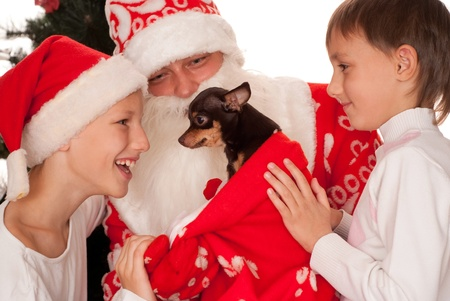 Santa gives presents to children on a white background photo