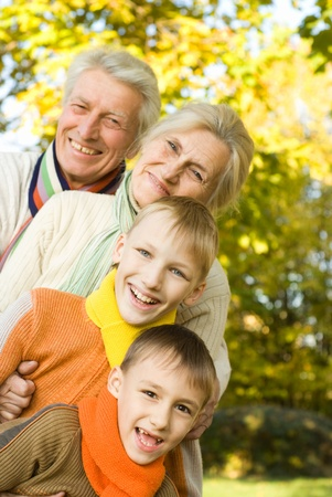 portrait of a happy family on the nature photo