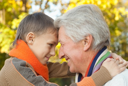 keeps: grandfather keeps his grandson in an outdoor