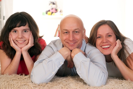 beautiful family of three on a light Stock Photo - 9265500