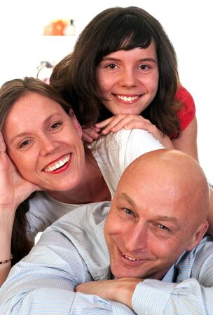 parent and teenager: beautiful family of three on a light
