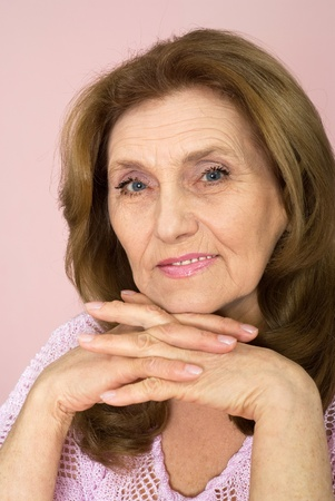 nice elderly woman on a pink background Stock Photo - 9265556