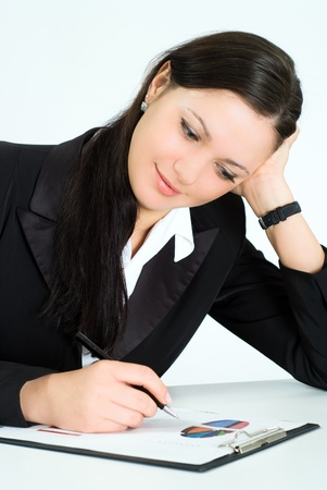nice girl in a business suit working in the office photo