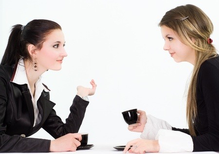 two beautiful businesswomen sitting at the table photo