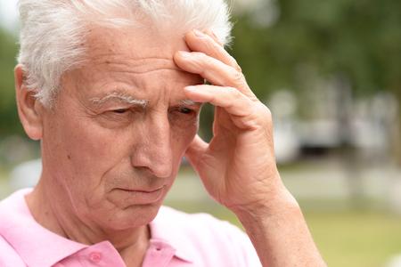Portrait of an sad elderly nice man close up