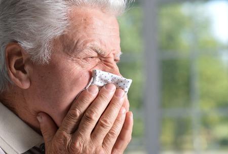 sad beautiful old man is sick in the room Standard-Bild