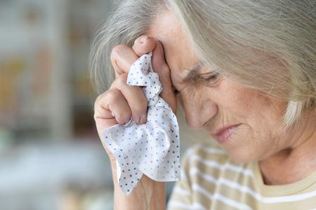 beautiful sad elderly woman in the room