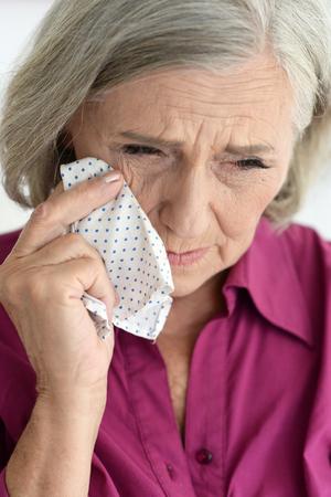 Portrait of an sad elderly woman close up