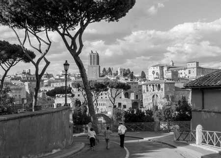 Rome, Italy - July 3, 2017 - Black and white image of people walking  through the streets of ancient Rome, Italy 報道画像