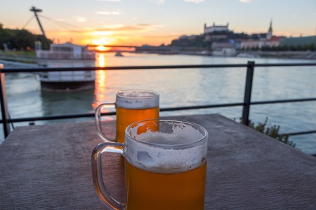 Beautiful sunset and lovely beers over the river Danube in Bratislava Slovakia