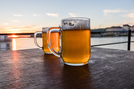 Two glass of beer on the brown wooden table, Slovakia