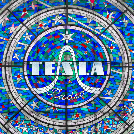 The glass with the Tesla Radio logo in Prague Editorial