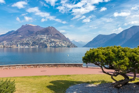 The picturesque lakeside city of Lugano is famous for its beautiful quasi-Mediterranean scenery