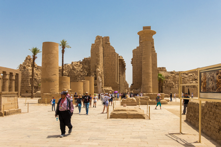 Luxor, Egypt - April 16, 2019: The Amun Temple Complex, the main entrance with tourists, Luxor, Egypt Editorial