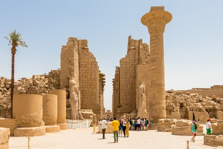 Luxor, Egypt - April 16, 2019: The Amun Temple Complex in Luxor, the main entrance with tourists, Luxor, Egypt