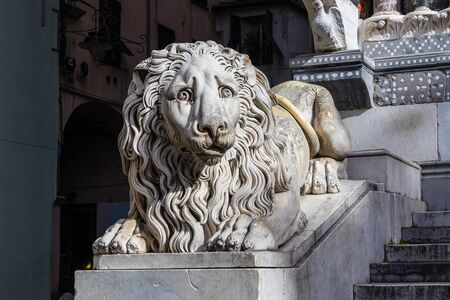 Sculpture of a sad lion in the Cathedral of Saint Lawrence in Genoa, Italy