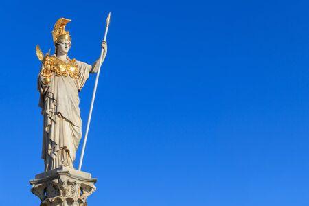 The statue of Pallas Athena on blue background Vienna, Austria