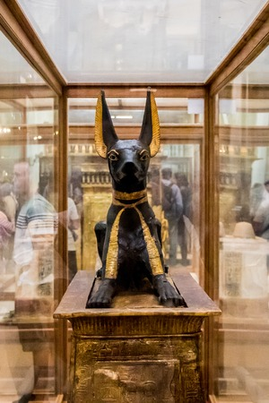 Cairo, Egypt - April 19, 2019: Anubis of Ancient Egypt God of Death. The Egyptian statue of God Anubis from Tutankhamun tomb in the Egyptian Museum, Cairo Redakční