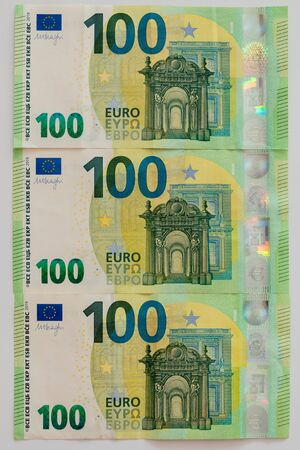 Euro currency, offers 100 euro bank note on white table European currency