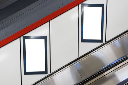 Two White Isolated advertisement billboard posters on train subway station Banco de Imagens