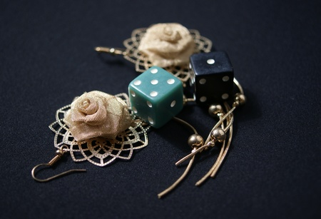 fate: ornament and dice against a dark textured background symbolizing wealth and fate