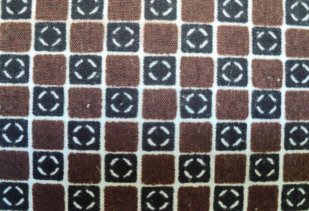 Dark brown cotton fabric, is a rough canvas background, texture close-up pattern.