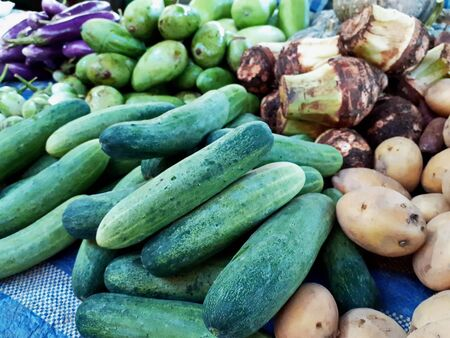 Cucumbers, potatoes, taro, raw mangoes, eggplants, and other fresh, vegetables are sold in stalls, Thailand in the countryside.